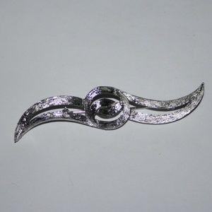 Long silver vintage brooch